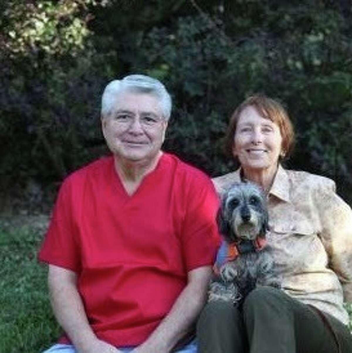 Carl and Linda Colmenares, pictured with their dog, Lulu, operate the Original Kennel of Kingwood.