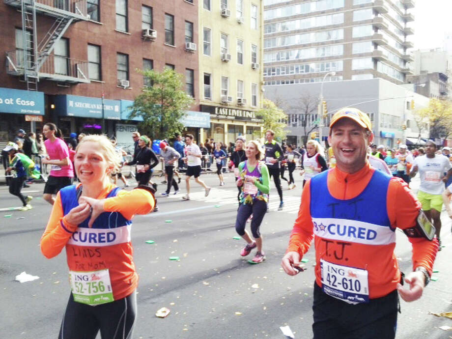 Lindsay Sheehy and her husband TJ ran in Sunday s New York City Marathon as part of a team to raise money for B*CURED, a Greenwich organization fighting brain cancer. Sheehy s mother, Kathryn Clauss, died of brain cancer days before the race. Photo: Contributed Photo / Greenwich Time contributed