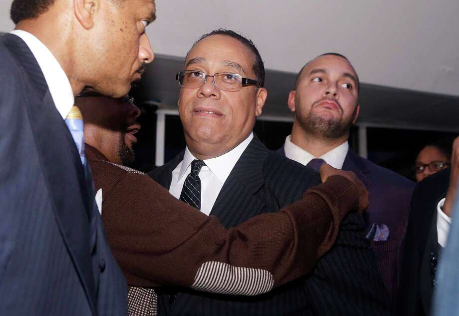 Detroit mayor candidate Benny Napoleon, center, is hugged after conceding the race to  ex-health care executive Mike Duggan during an election night watch party in Detroit, Tuesday, Nov. 5, 2013. Unofficial returns showed Duggan leading Napoleon 55 percent to 45 percent with 99 percent of precincts reporting. (AP PhotoCarlos Osorio) Photo: Carlos Osorio, STF / AP