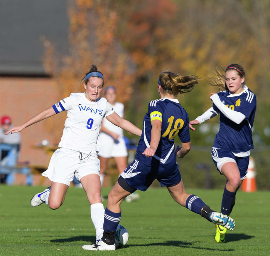 Darien's Emily Stein (No. 9) battles for possession during the Blue Wave's 2-0 loss to Simsbury at Darien High School on Monday. Contributed photo by Mark Maybell and the Darien Athletic Foundation. Photo: Contributed Photo / Darien News