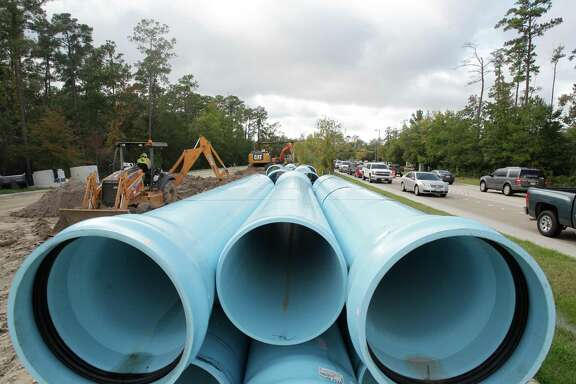 An official with the San Jacinto River Authority, which is installing a water line alongside Research Forest Drive in The Woodlands, said the project could have cost $200 million less under the Proposition 6 initiative.