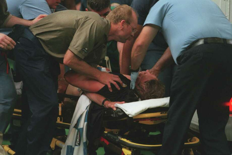 Larry Dierker is attended to after collapsing in 1999. Photo: Kevin Fujii, Staff / Houston Chronicle