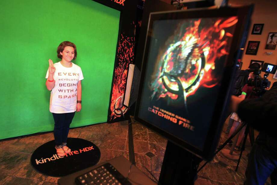 Solesha Shea, 14, poses for a photo during The Hunger Games: Catching Fire Victory Tour. Photo: Mayra Beltran, Houston Chronicle / © 2013 Houston Chronicle