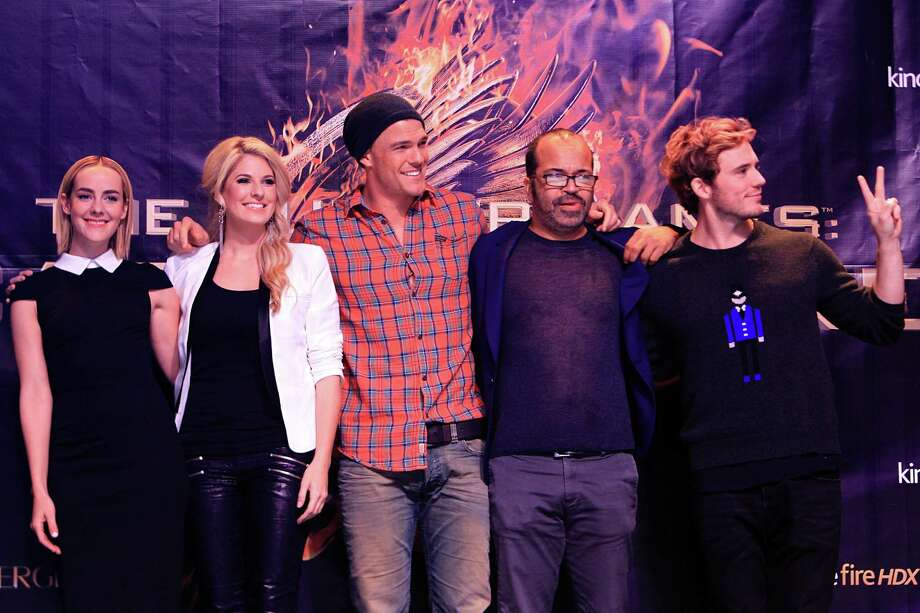 "Jena Malone, ""Johanna"", Stephanie Leigh Schlund,  ""Cashmere"", Alan Ritchson, ""Gloss"", Jeffrey Wright, ""Beetee"", and Sam Claflin, ""Finnick"", pose for a photo during The Hunger Games: Catching Fire Victory Tour. Photo: Mayra Beltran, Houston Chronicle / © 2013 Houston Chronicle"
