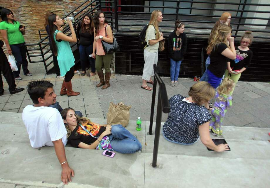 Fans wait outside the Bayou Music Center for The Hunger Games: Catching Fire Victory Tour. Photo: Mayra Beltran, Houston Chronicle / © 2013 Houston Chronicle