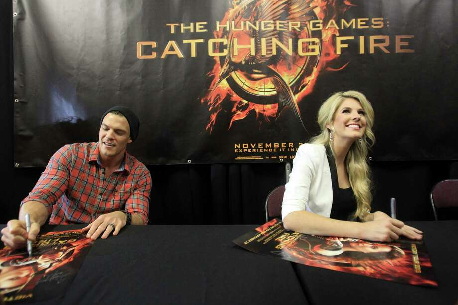 "Alan Ritchson, ""Gloss"", and Stephanie Leigh Schlund, ""Cashmere"", sign autographs during The Hunger Games: Catching Fire Victory Tour. Photo: Mayra Beltran, Houston Chronicle / © 2013 Houston Chronicle"