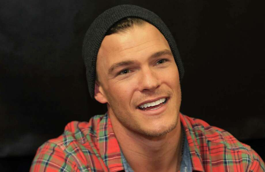 "Alan Ritchson, ""Gloss"", signs autographs during The Hunger Games: Catching Fire Victory Tour. Photo: Mayra Beltran, Houston Chronicle / © 2013 Houston Chronicle"