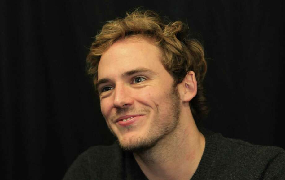 "Sam Claflin, ""Finnick"", during The Hunger Games: Catching Fire Victory Tour at the Bayou Music Center. Photo: Mayra Beltran, Houston Chronicle / © 2013 Houston Chronicle"