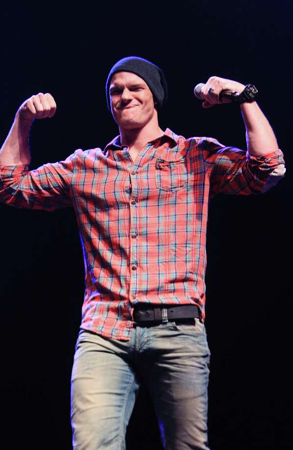 "Alan Ritchson, ""Gloss"", arrives to the questions-and-answer session during The Hunger Games: Catching Fire Victory Tour at the Bayou Music Center. Photo: Mayra Beltran, Houston Chronicle / © 2013 Houston Chronicle"