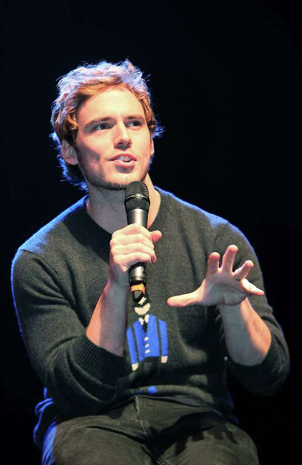"Sam Claflin, ""Finnick"", answers questions during The Hunger Games: Catching Fire Victory Tour at the Bayou Music Center. Photo: Mayra Beltran, Houston Chronicle / © 2013 Houston Chronicle"