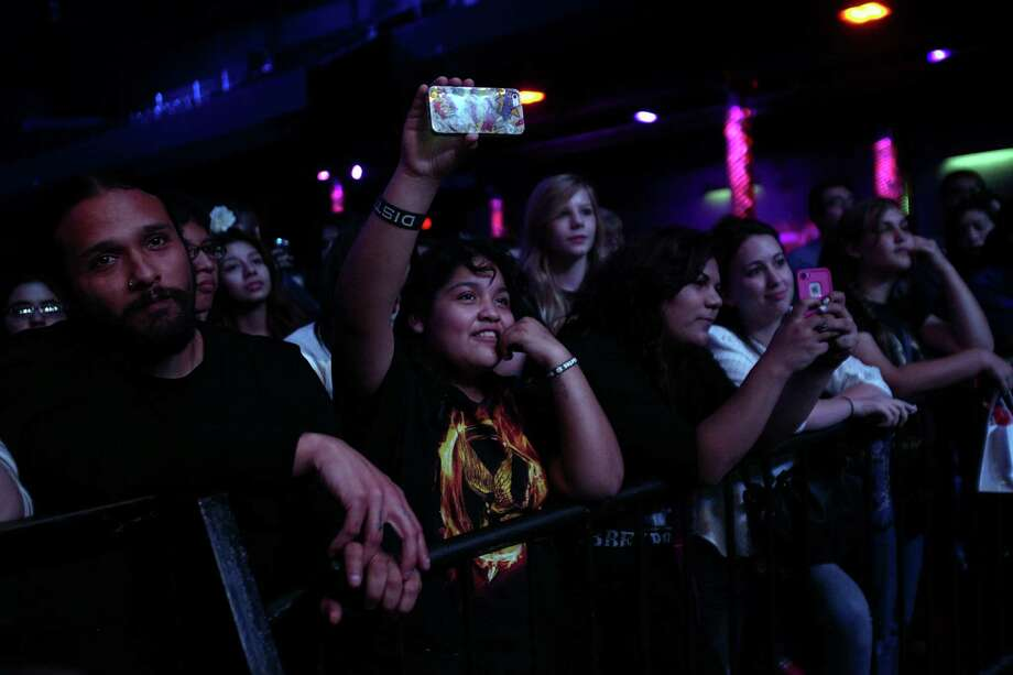 Fans listen to actors during a Q&A session at The Hunger Games: Catching Fire Victory Tour at the Bayou Music Center on Wednesday, Nov. 6, 2013, in Houston.  The movie will be released worldwide on Nov. 22.  \ Photo: Mayra Beltran, Houston Chronicle / © 2013 Houston Chronicle