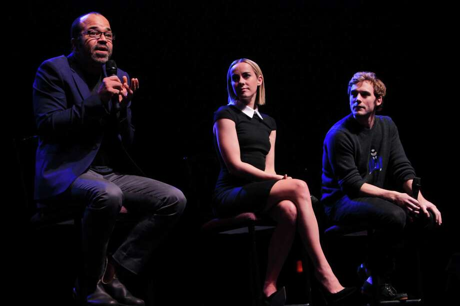 "Jeffrey Wright, ""Beetee"", answers question while Jena Malone, ""Johanna"", and Sam Claflin, ""Finnick"", listen  during The Hunger Games: Catching Fire Victory Tour. Photo: Mayra Beltran, Houston Chronicle / © 2013 Houston Chronicle"