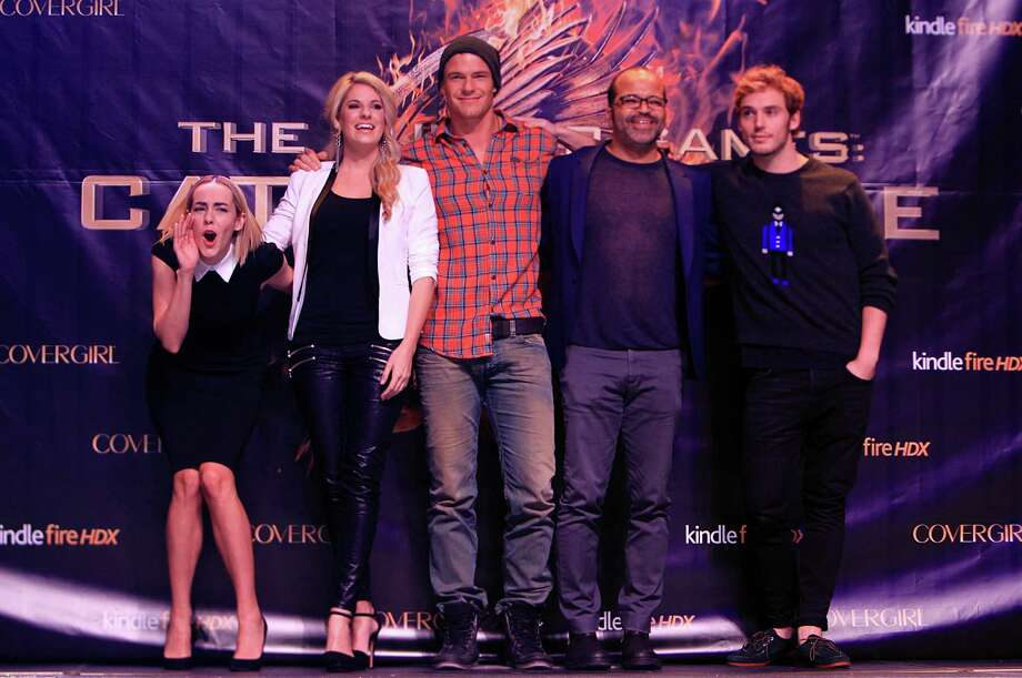 """We Love You!"" screams Jena Malone, ""Johanna"", to fans as Stephanie Leigh Schlund,  ""Cashmere"", Alan Ritchson, ""Gloss"", Jeffrey Wright, ""Beetee"", and Sam Claflin, ""Finnick"", pose for a photo during The Hunger Games: Catching Fire Victory Tour at the Bayou Music Center. Photo: Mayra Beltran, Houston Chronicle / © 2013 Houston Chronicle"