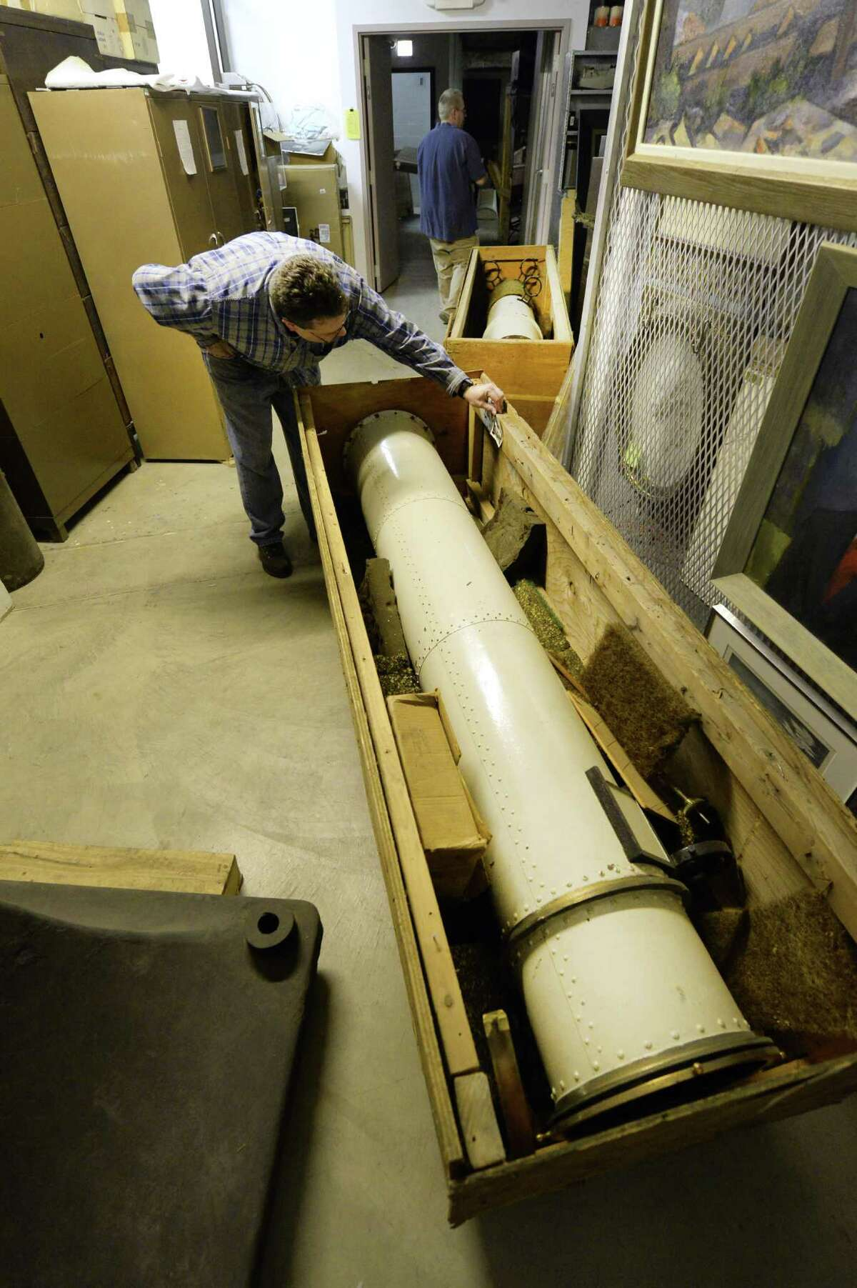 Archivist Josh Hauck looks over pieces of the original Dudley Observatory telescope which moved in to it's new home at the miSci(former Schenectady Museum) Wednesday afternoon Nov. 6, 2013 in Schenectady, N.Y. (Skip Dickstein / Times Union)