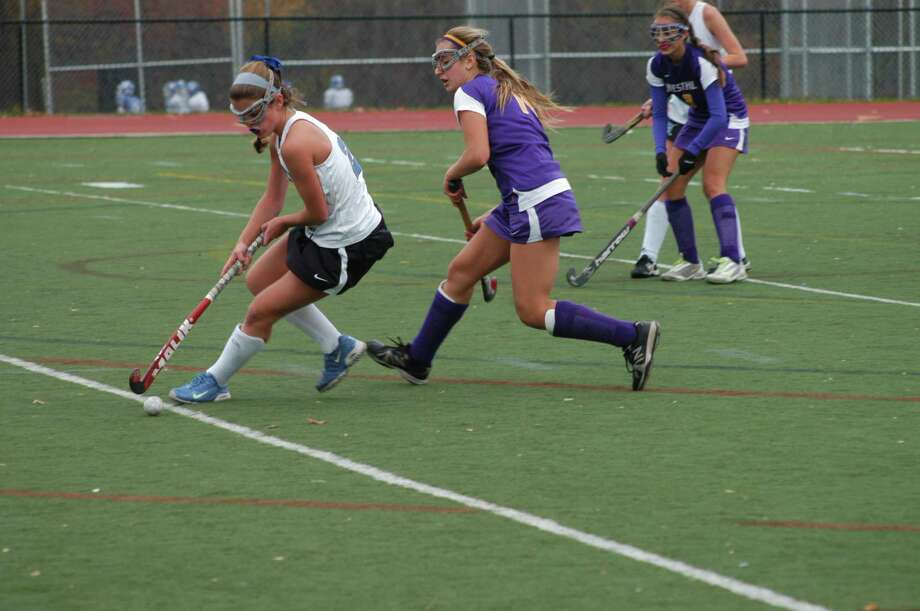 Darien's Georgia Cassidy battles against Westhill's Ashley Rich during Darien's 1-0 win in the first round of the state tournament at Darien High School on Wendesday, Nov. 6. By Andy Hutchison Photo: Contributed Photo / Darien News