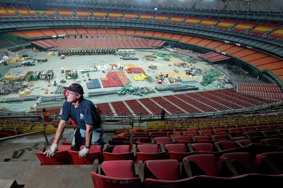 Charles Warren works on removing seats from the upper levels of the Astrodome as items are prepared to be sold.