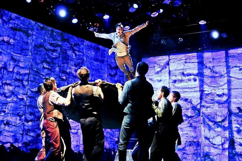 "Joey deBettencourt as Boy falls into a mysterious grotto - getting a little help from the cast of the touring company of ""Peter and the Starcatcher"" at the Curran Theatre in S.F. Photo: Jenny Anderson"