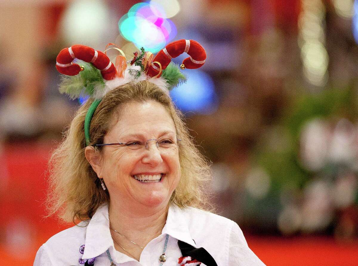Volunteer Joanie Levy wears a festive headpiece while walking the aisles at the 33rd annual Nutcracker Market at Reliant Center Wednesday, Nov. 6, 2013, in Houston. More than 100,000 attendees are expected at this year's Nutcracker Market, which benefits Houston Ballet. The event, featuring hundreds of vendors selling holiday items, gifts and sweets, runs through Sunday. Admission at the door is $14.
