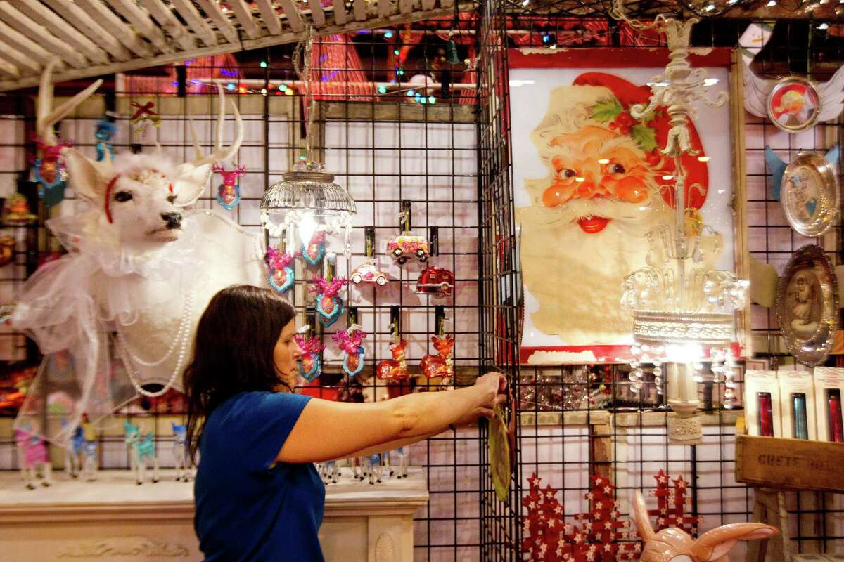 Mary Lue Kopech hangs Christmas items in the Truly Blessed booth at the 33rd annual Nutcracker Market at Reliant Center Wednesday, Nov. 6, 2013, in Houston.