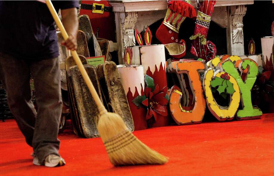 Antonio Vasquez sweeps up the carpet before the opening of the 33rd annual Nutcracker Market at Reliant Center Wednesday, Nov. 6, 2013, in Houston. Photo: Johnny Hanson, Houston Chronicle / Houston Chronicle