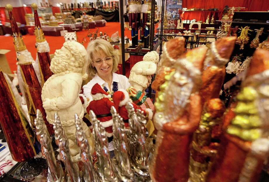 Sarah Kelly stocks shelves with Christmas items at the Brookwood Community Store booth at the 33rd annual Nutcracker Market at Reliant Center Wednesday, Nov. 6, 2013, in Houston. Photo: Johnny Hanson, Houston Chronicle / Houston Chronicle