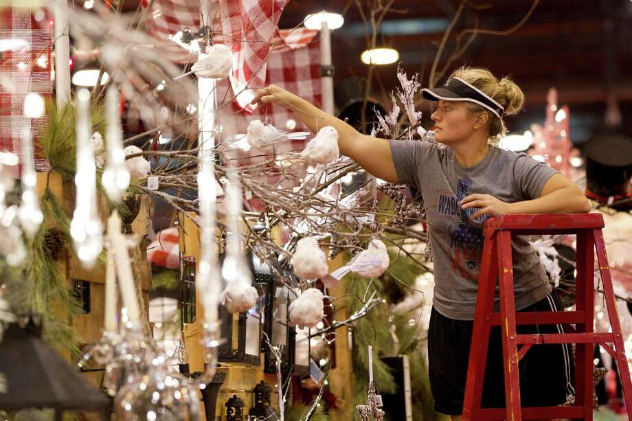 Amber Welch with Amber Marie and Company, hangs bird ornaments on her booth at the 33rd annual Nutcracker Market at Reliant Center Wednesday, Nov. 6, 2013, in Houston. Photo: Johnny Hanson, Houston Chronicle / Houston Chronicle