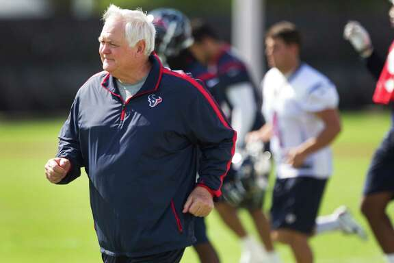 Interim head coach Wade Phillips hits the field running for the Texans' practice Wednesday at the Methodist Training Center.
