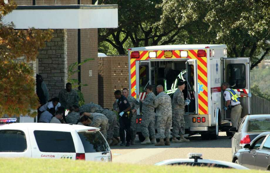 File - In this Nov. 5, 2009, file photo, released by the U.S. Army, wounded are prepared for transport in waiting ambulances outside Fort Hood's Soldier Readiness Processing Center in Fort Hood, Texas, where Army psychiatrist Nidal Hasan fatally shot 13 people and wounded over 30 others. Public works officials at Fort Hood on Tuesday Nov. 5, 2013, the fourth anniversary of the rampage, announced plans to raze the structure that's part of the Soldier Readiness Processing Center. (AP Photo/U.S. Army, Jeramie Sivley, File) Photo: Jeramie Sivley, HOPD / U.S. Army