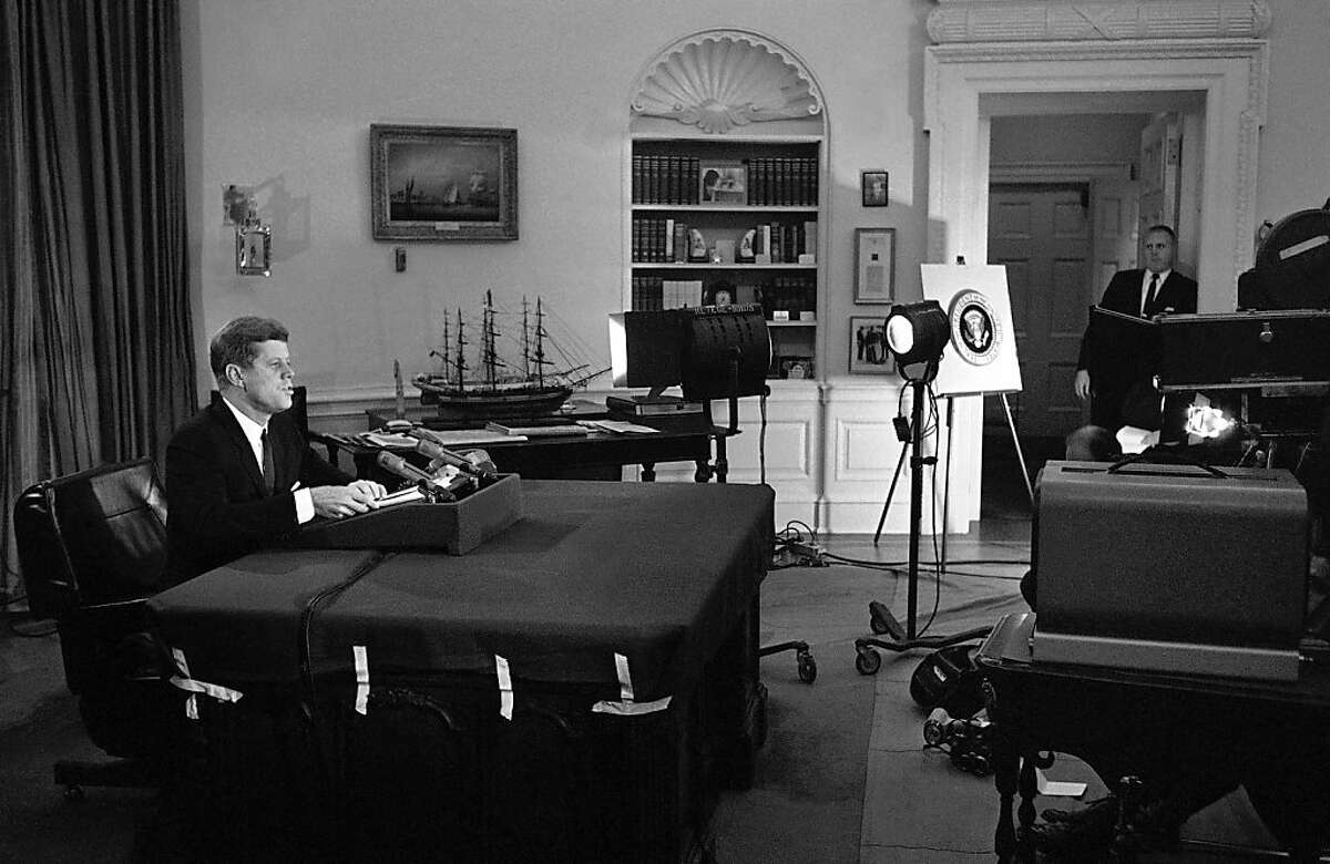 FILE - In this Oct. 22, 1962 file photo, U.S. President John F. Kennedy addresses the nation by television and radio from the Oval Office in Washington, announcing a U.S. naval blockade of Cuba. (AP Photo/WOA)