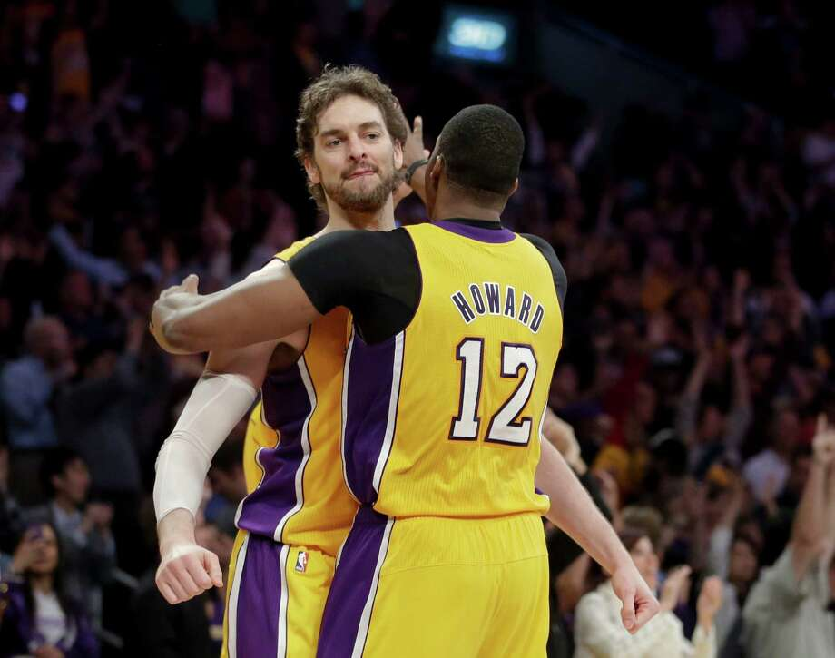 Pau Gasol, left, is not looking forward to playing against Dwight Howard after they were teammates for one season with the Lakers. Photo: Jae C. Hong, STF / AP