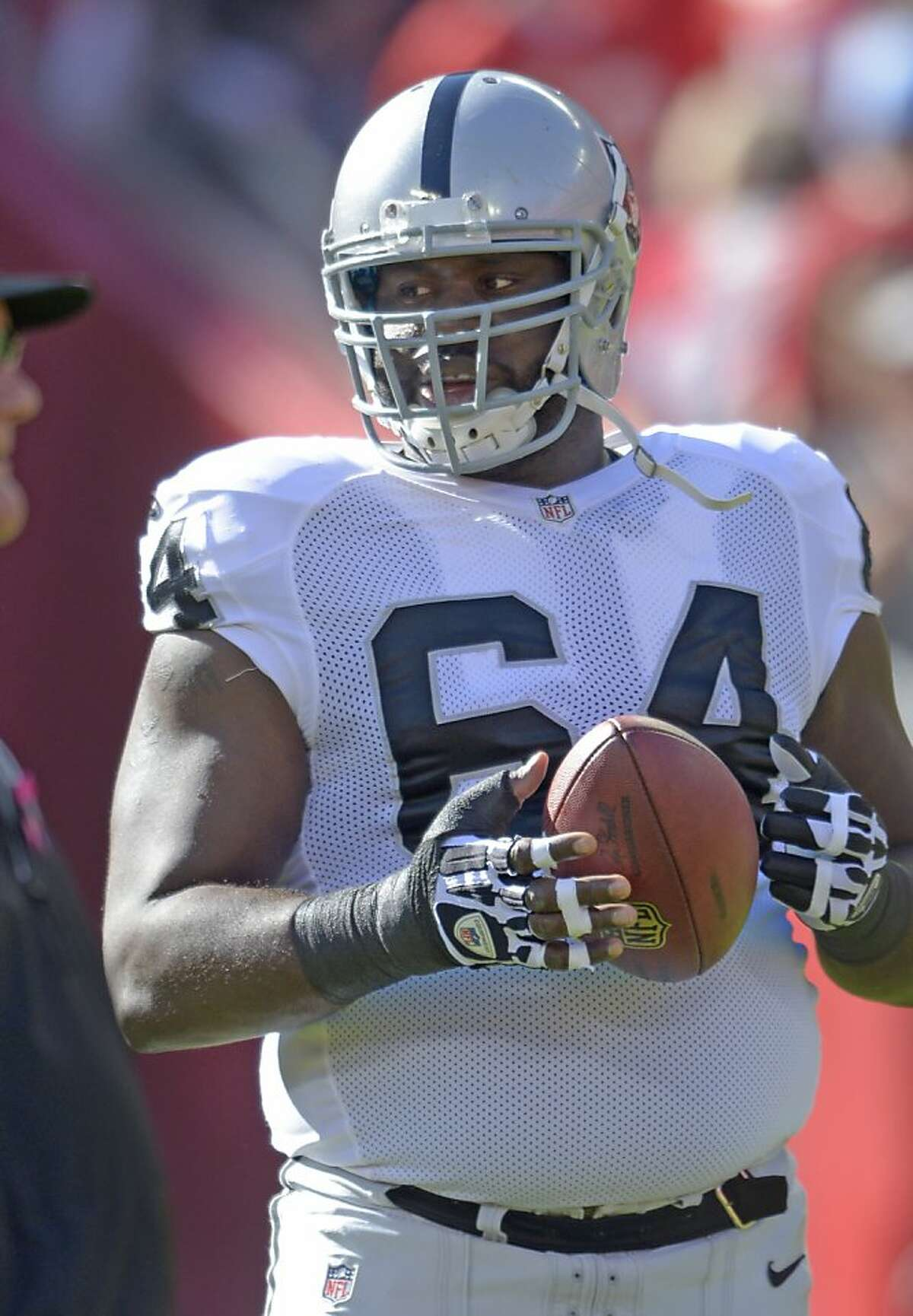Oakland Raiders guard Andre Gurode (64) during pre-game warmups for an NFL football game in Kansas City, Mo., Sunday, Oct. 13, 2013. (AP Photo/Reed Hoffmann)