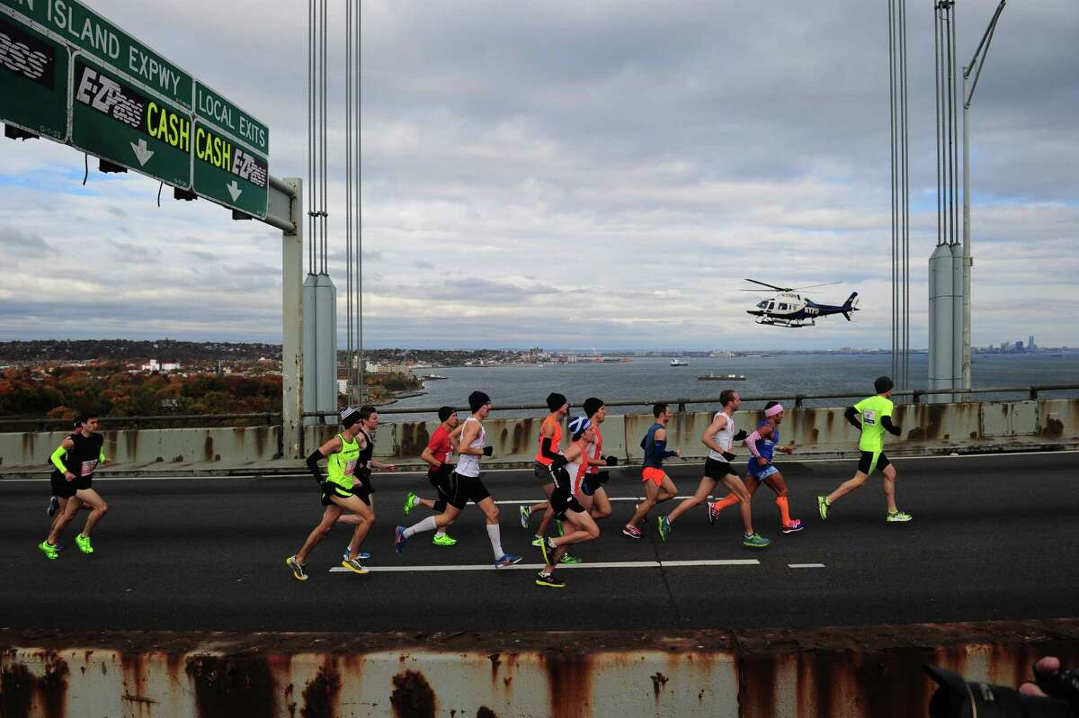 Zachary Cater-Cyker, fourth from the right, was the top Texas finisher at Sunday's New York City Marathon and then got an unexpected souvenir when his picture appeared in Monday's New York Times.