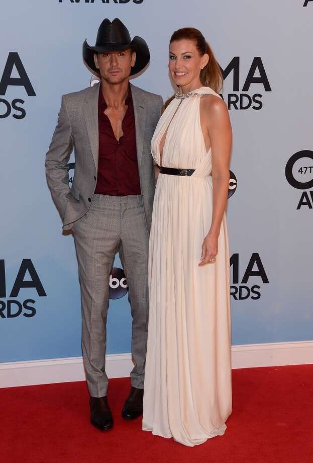 Tim McGraw (L) and Faith Hill attend the 47th annual CMA Awards at the Bridgestone Arena on November 6, 2013 in Nashville, Tennessee. Photo: Larry Busacca, WireImage