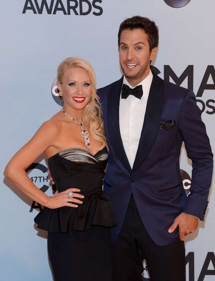 Singer Luke Bryan (R) and wife Caroline Boyer attends the 47th annual CMA Awards at the Bridgestone Arena on November 6, 2013 in Nashville, Tennessee. Photo: Larry Busacca, WireImage