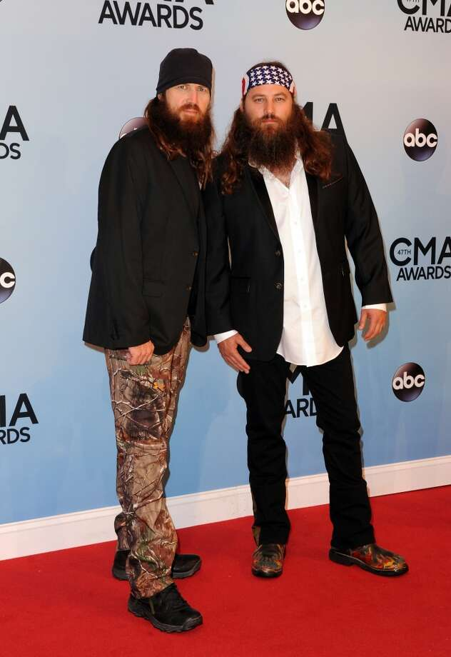 "(L-R) TV Personalities Jase Robertson and Willie Robertson of the hit show ""Duck Dynasty"" attend the 47th annual CMA Awards at the Bridgestone Arena on November 6, 2013 in Nashville, Tennessee. Photo: Jon Kopaloff, FilmMagic"