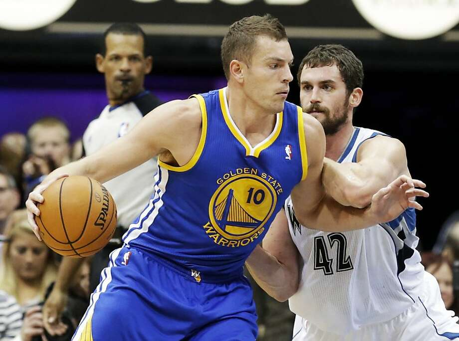 David Lee tries to maneuver past Minnesota's Kevin Love. Lee had 22 points and 15 rebounds. Photo: Jim Mone, Associated Press