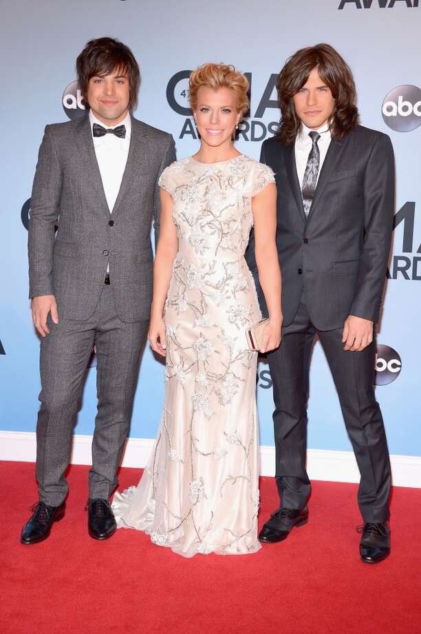 (L-R) Musicians Neil Perry, Kimberly Perry, and Reid Perry of The Band Perry attend the 47th annual CMA Awards at the Bridgestone Arena on November 6, 2013 in Nashville, Tennessee. Photo: Michael Loccisano, Getty Images