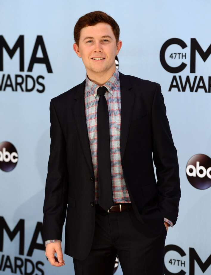 Scotty McCreery arrives at the 47th annual CMA Awards at Bridgestone Arena on Wednesday, Nov. 6, 2013, in Nashville, Tenn. Photo: Evan Agostini, Associated Press