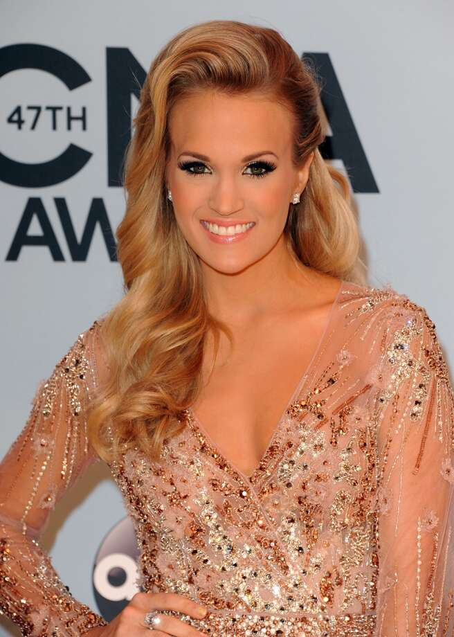 Musician Carrie Underwood attends the 47th annual CMA Awards at the Bridgestone Arena on November 6, 2013 in Nashville, Tennessee. Photo: Jon Kopaloff, FilmMagic