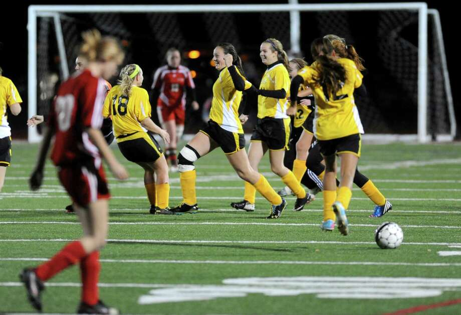 Canajoharie celebrates after defeating Waterford 3-0 in  their Class C Section II girls' soccer finals on Wednesday Nov. 6, 2013 in Stillwater, N.Y. (Michael P. Farrell/Times Union) Photo: Michael P. Farrell / 00024513A