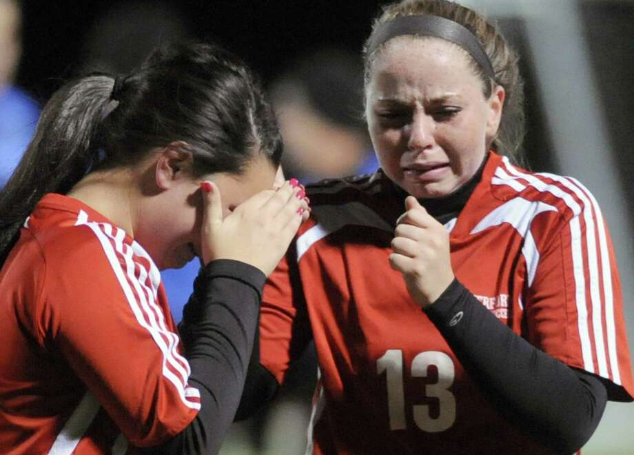 Waterford's Amanda Briell and Carly Bazill react after losing 3-0 to Canajoharie in their Class C Section II girls' soccer finals on Wednesday Nov. 6, 2013 in Stillwater, N.Y. (Michael P. Farrell/Times Union) Photo: Michael P. Farrell / 00024513A