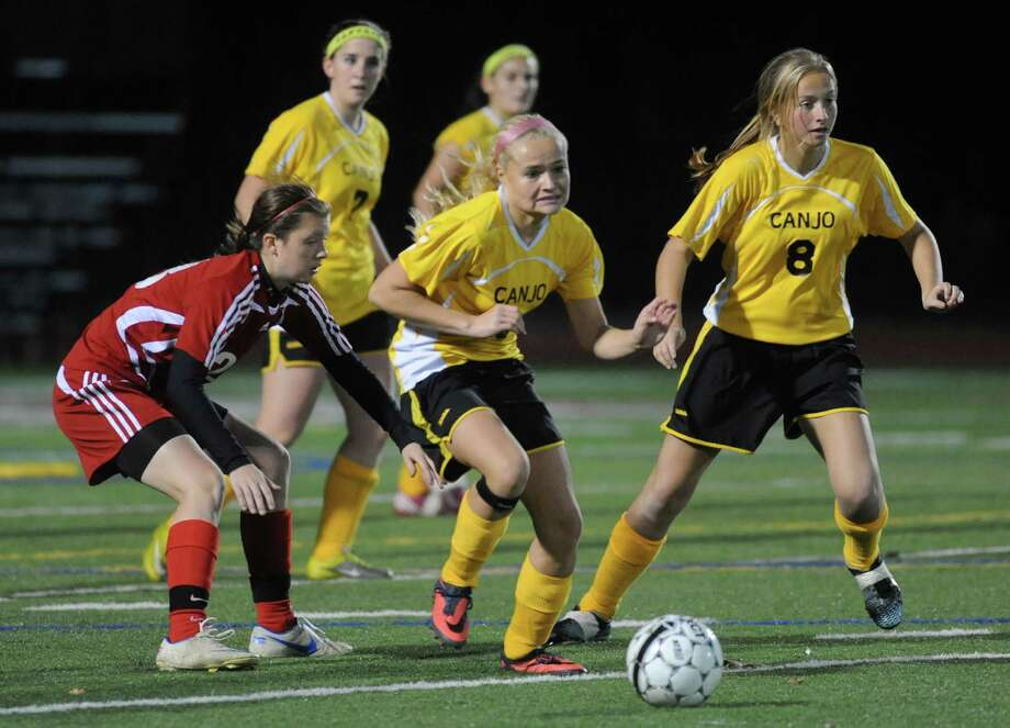 Canajoharie's Dainara Veeder, center, take control of the ball during their Class C Section II girls' soccer finals against Waterford on Wednesday Nov. 6, 2013 in Stillwater, N.Y. (Michael P. Farrell/Times Union) Photo: Michael P. Farrell / 00024513A