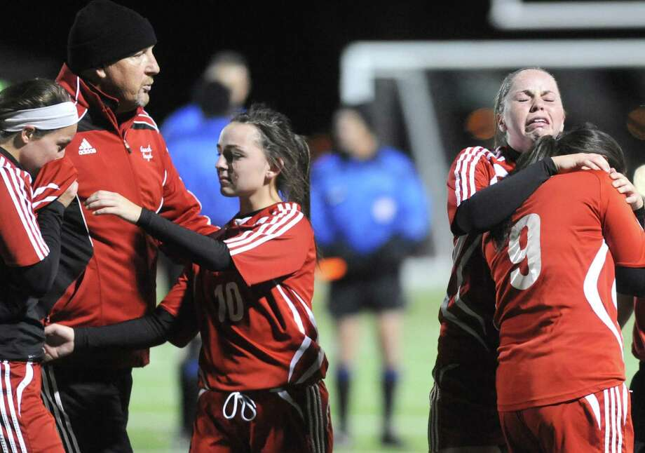 Waterford's Carly Bazill and Amanda Briell, right, hug after losing 3-0 to Canajoharie in their Class C Section II girls' soccer finals on Wednesday Nov. 6, 2013 in Stillwater, N.Y. (Michael P. Farrell/Times Union) Photo: Michael P. Farrell / 00024513A