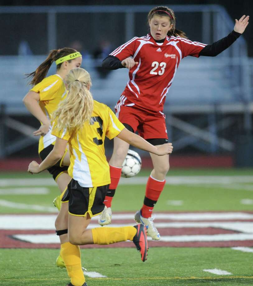 Waterford's Abby Fountain, left, and Canajoharie's Hannah Bowerman and Dainara Veeder battle for the ball during their Class C Section II girls' soccer finals on Wednesday Nov. 6, 2013 in Stillwater, N.Y. (Michael P. Farrell/Times Union) Photo: Michael P. Farrell / 00024513A