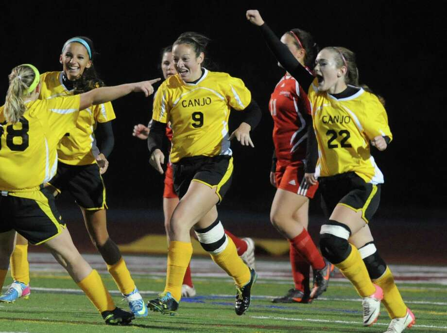 Canajoharie celebrates after #9 Morgan Koelbl, center, scored a goal during their Class C Section II girls' soccer finals against Waterford on Wednesday Nov. 6, 2013 in Stillwater, N.Y. (Michael P. Farrell/Times Union) Photo: Michael P. Farrell / 00024513A