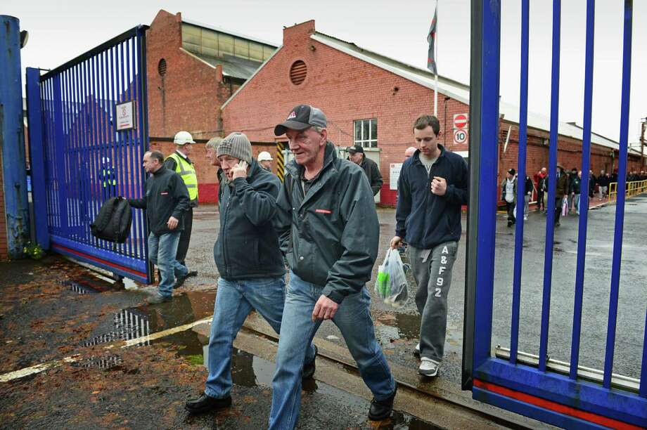 GLASGOW, SCOTLAND - NOVEMBER 06:  Shipyard workers leave the BAE systems yard in Govan following the announcement that the company will be cutting jobs on November 6, 2013 in Glasgow, Scotland. The cuts are being made following a decline in orders, with 1775 jobs going between the yards in Scotland and England with the end of shipbuilding altogether at the Portsmouth yard.  (Photo by Jeff J Mitchell/Getty Images) Photo: Jeff J Mitchell, Staff / 2013 Getty Images