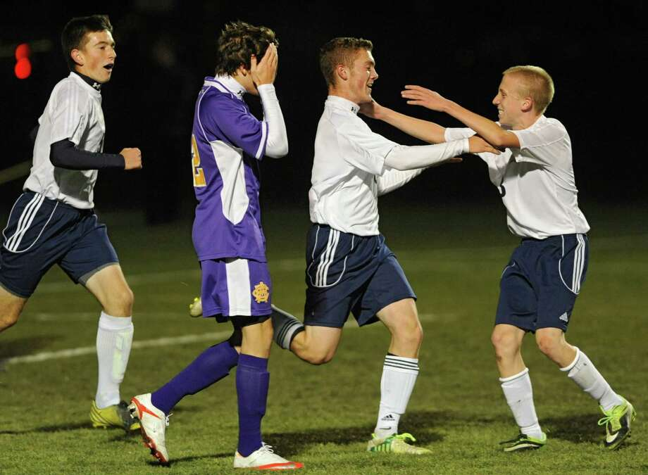 Averill Park's Ben Reinisch, center, and Matt Regan, right, celebrate after Reinisch's goal against (Syracuse) CBA during the boys' soccer Class A regional on Wednesday, Nov. 6, 2013 in Colonie, N.Y.  Averill Park's Alex Miller is on left. (Lori Van Buren / Times Union) Photo: Lori Van Buren / 00024528A