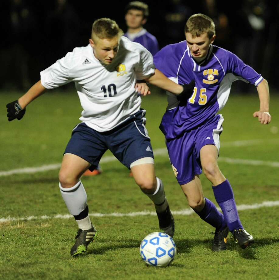 Averill Park's Josh Lionarons, left, battles for the ball with (Syracuse) CBA's Thomas Reith during the boys' soccer Class A regional on Wednesday, Nov. 6, 2013 in Colonie, N.Y.  (Lori Van Buren / Times Union) Photo: Lori Van Buren / 00024528A