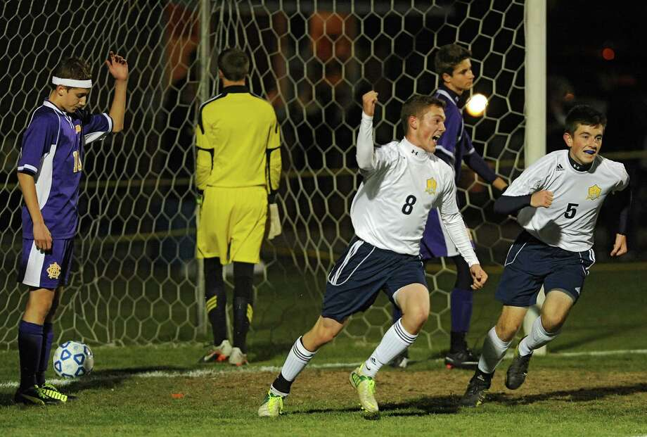 Averill Park's Ben Reinisch, left, and Alex Miller celebrate after Reinisch's goal against (Syracuse) CBA during the boys' soccer Class A regional on Wednesday, Nov. 6, 2013 in Colonie, N.Y.  (Lori Van Buren / Times Union) Photo: Lori Van Buren / 00024528A