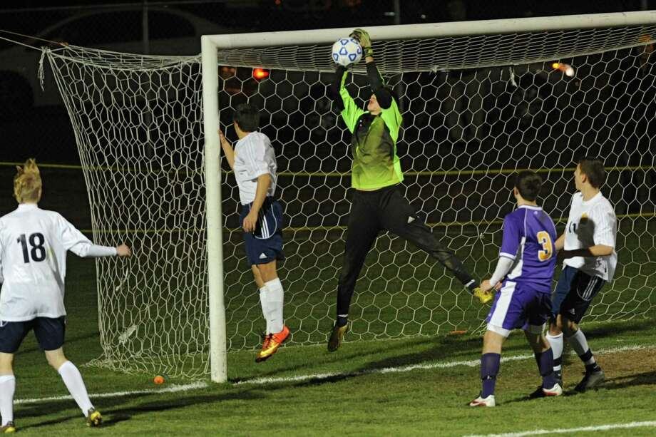 Averill Park keeper Hunter DuPont makes a save during the boys' soccer Class A regional against (Syracuse) CBA on Wednesday, Nov. 6, 2013 in Colonie, N.Y.  (Lori Van Buren / Times Union) Photo: Lori Van Buren / 00024528A